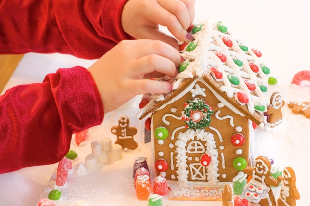 child-decorating-a-gingerbread-house